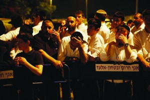 "People gathered at a police barrier in the town of Elad, outside the home of Eyal Yifrach, Hy""d, one of three bachurim found murdered on Monday. (REUTERS/Finbarr O'Reilly)"