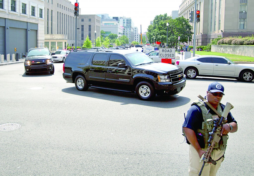 Motorcade transporting Ahmed Abu Khattala, charged in the Benghazi attack at the U.S. embassy in Libya, leaves the U.S. District Court in Washington. (AP Photo/Jose Luis Magana)