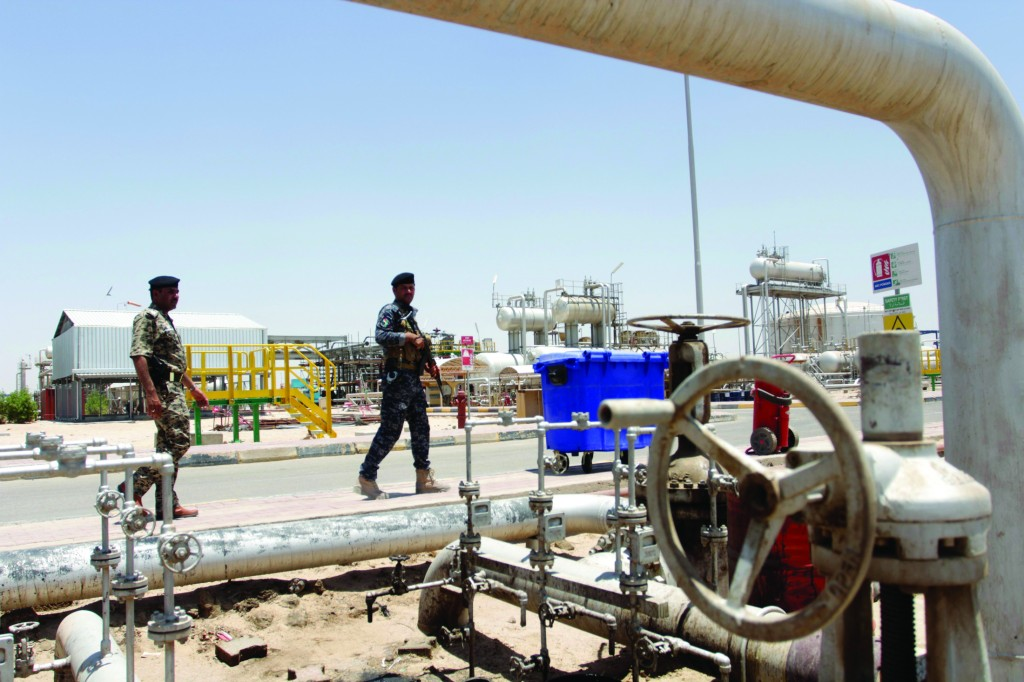 Members from the oil police force stand guard at Zubair oilfield in Basra, southeast of Baghdad. (REUTERS/ Essam Al-Sudani)