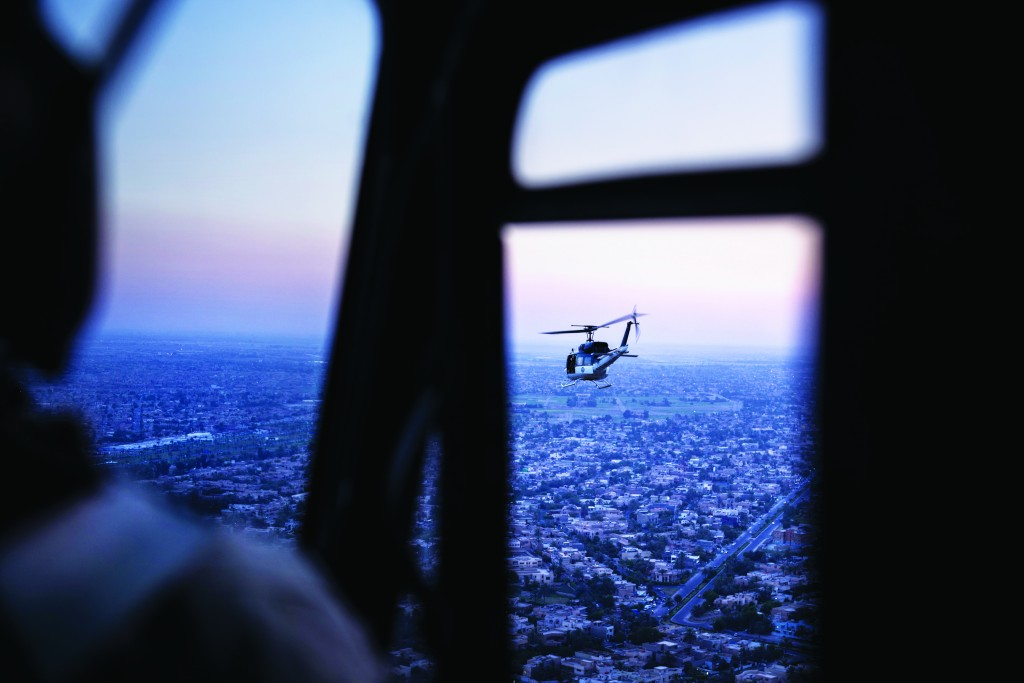 A photo taken on board a helicopter shows a U.S. State Department helicopter flying over Iraq's capital, Baghdad, Monday. It is carrying Secretary of State John Kerry.  (AP Photo/Brendan Smialowski, Pool)