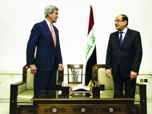Secretary of State John Kerry (L) meets with Iraqi Prime Minister Nouri al-Maliki  (R) at the Prime Minister's office in Baghdad on Monday.  (AP Photo/Brendan Smialowski, Pool)