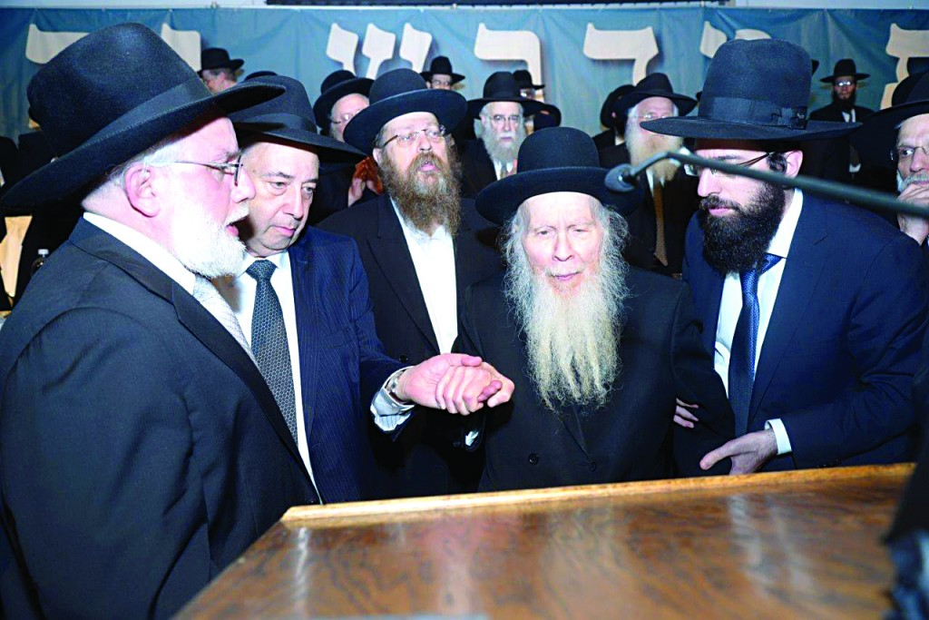 At Lakewood's Evening of Chizuk for Bais Medrash Govoha's kollel, on Wednesday night, Harav Aryeh Finkel, shlita, attended as a special guest from Eretz Yisrael (right). It is believed that the Rosh Yeshivah of Yeshivas Mir-Brachfeld was in the United States for his first time. On Thursday, the Rosh Yeshivah delivered a shiur in the yeshivah . (JDN/Kuvien Images)