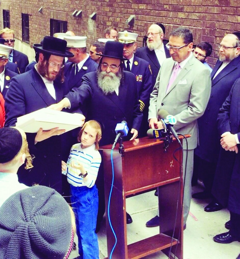 Mendy Gotlieb, 7, on Thursday at a news conference in Williamsburg to thank firefighters for rescuing him from a roll-up gate last month. (FDNY)