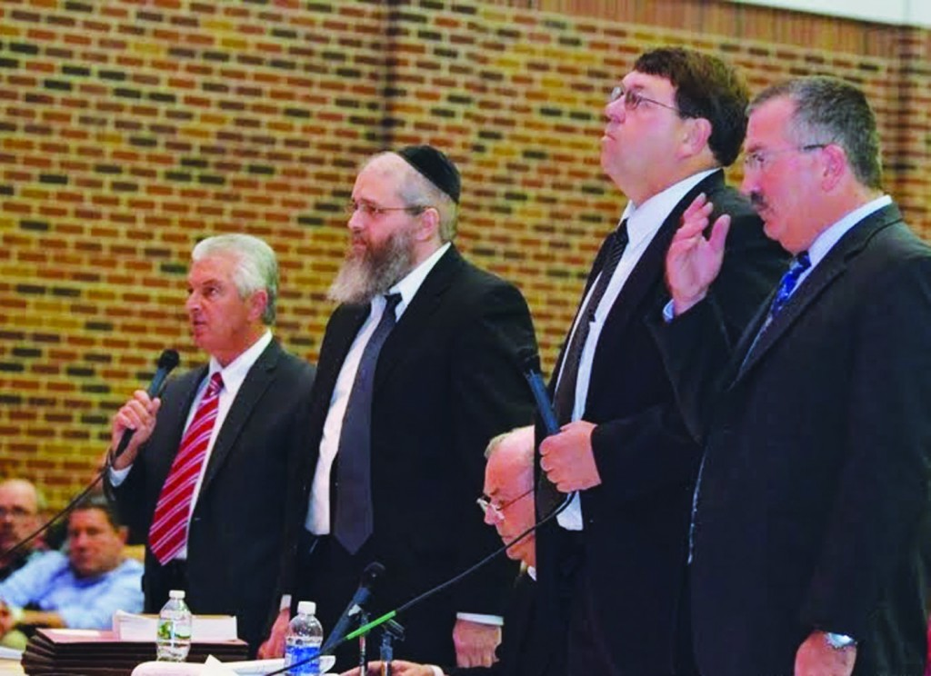 Rabbi Efraim Birnbaum (C) stands with his attorney Raymond Shea at a previous Jackson zoning board hearing, which rejected his school Wednesday. (TheLakewoodScoop.com)