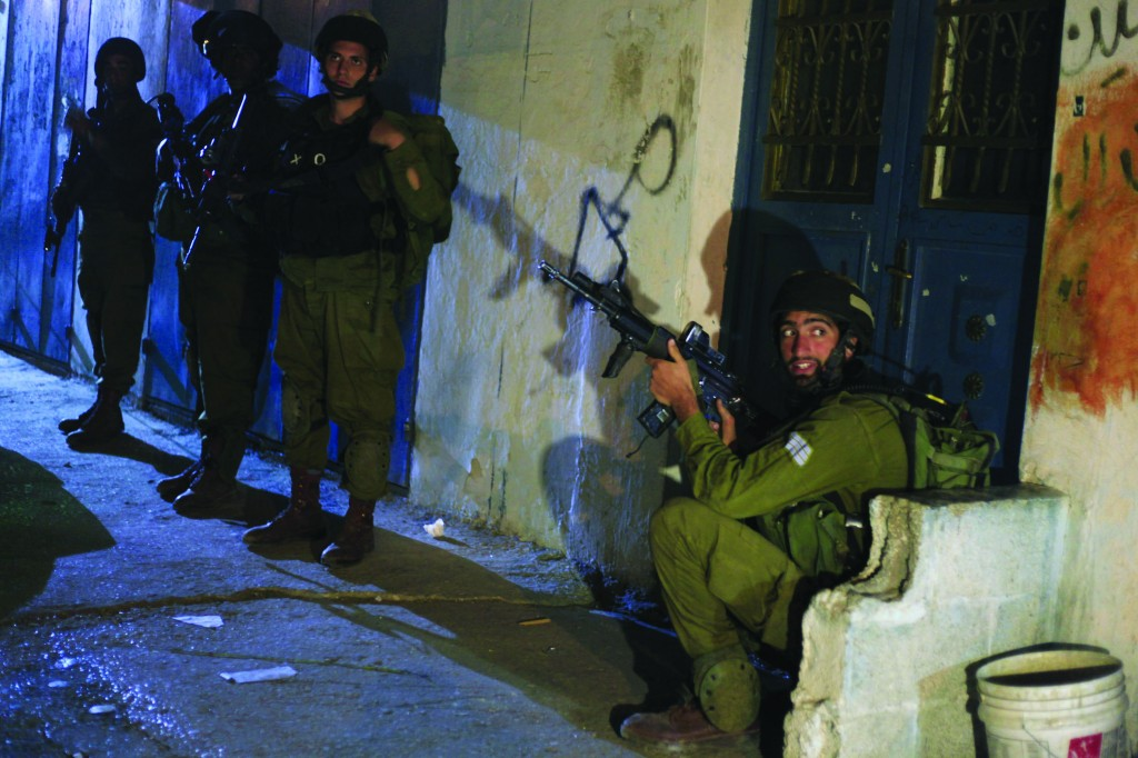 Israeli soldiers in Chevron during search efforts for the three kidnapped Jewish teenagers, on Monday.  (Issam Rimawi/FLASH90)
