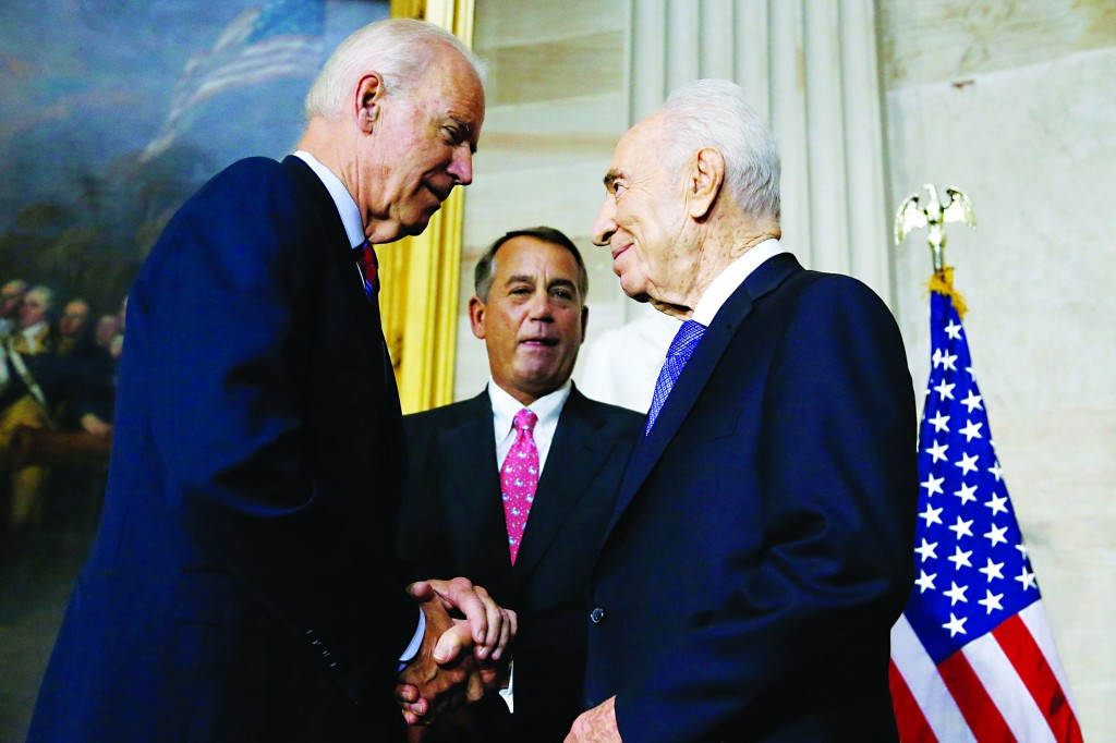Vice President Joe Biden (L) shakes hands with Israel's President Shimon Peres (R) after Peres received the Congressional Gold Medal, the highest honor the U.S. legislature can confer, from congressional leaders including House Speaker John Boehner (R-OH) (C) during a ceremony in the rotunda of the U.S. Capitol in Washington on Thursday. (REUTERS/Jonathan Ernst)