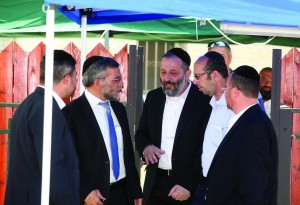 Leader of Shas party Aryeh Deri (C) visiting the home of Ori and Iris Yifrach, parents of kidnapped teenager Eyal Yifrach, in Elad, on Monday.  (Gideon Markowicz/Flash90)