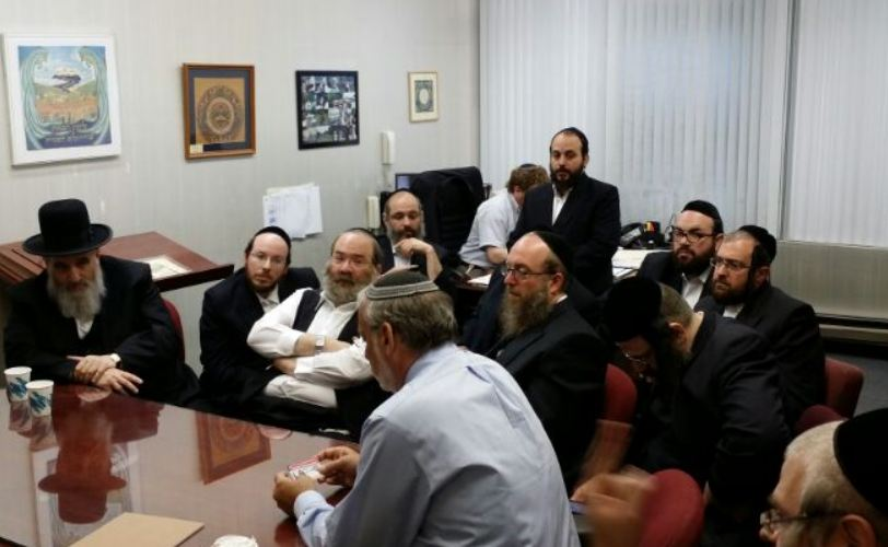 Three TLC commissioners meet with Assemblyman Dov Hikind on Friday at his Boro Park office to devise a new protocol to protect volunteers who transport patients. (Office of Assemblyman Hikind)