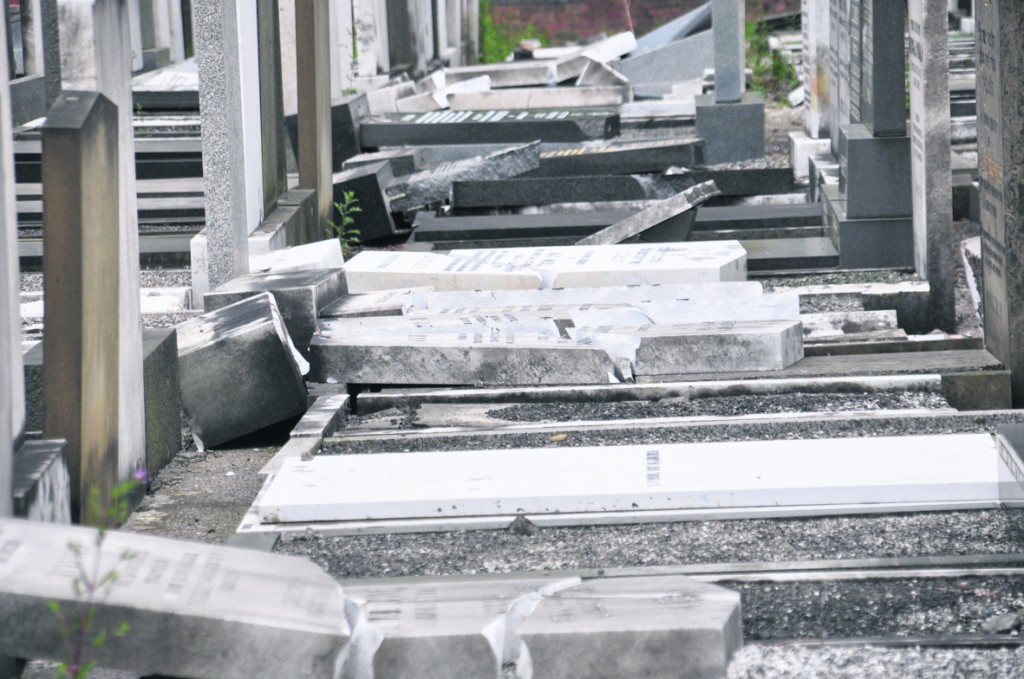 A view of the damaged matzeivos at a Jewish cemetery in Manchester, England, discovered Monday.