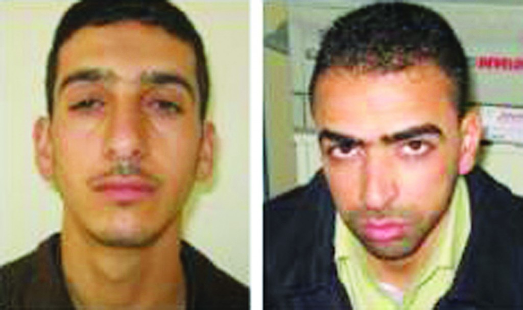 Marwan Quasma (L) and Amar Abu Eisha (R), the two Hamas operatives wanted for the kidnapping of the three Israeli teens. (EPA/ISRAELI DEFENSE FORCES)
