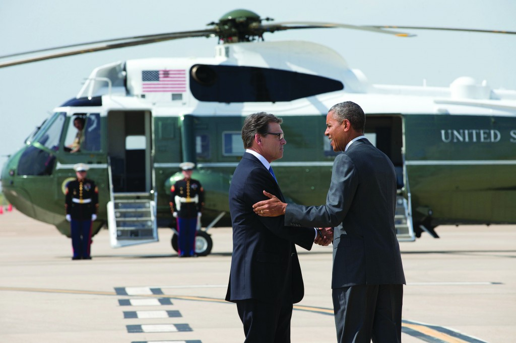 President Barack Obama is greeted by Texas Gov. Rick Perry as he arrives at Dallas/Fort Worth International Airport, Wednesday. (AP Photo/Jacquelyn Martin)