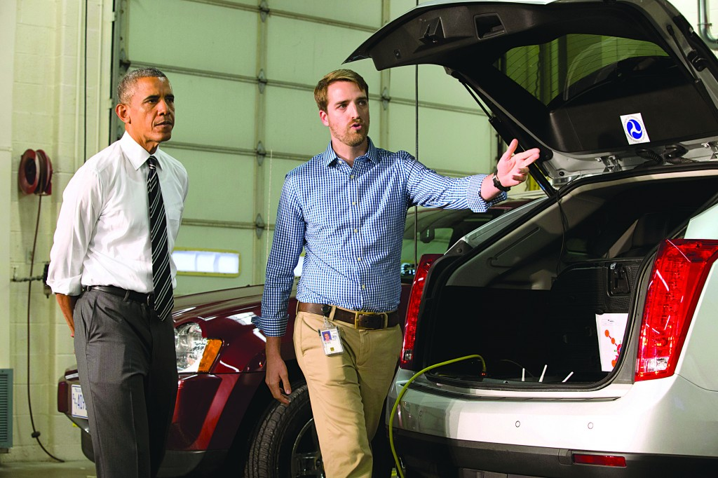 President Barack Obama tours Turner-Fairbank Highway Research Center with Taylor Lochrene, in McLean, Va., Tuesday.  (AP Photo/Jacquelyn Martin)