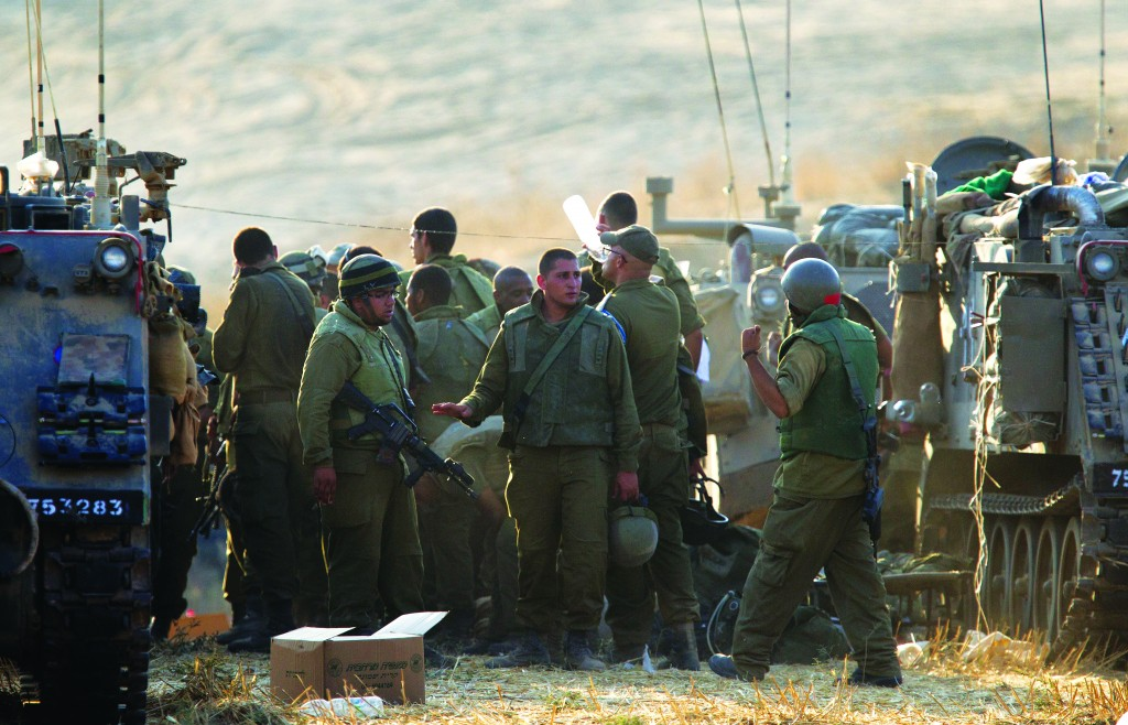 Israeli soldiers in a staging area close to the Gaza Strip border, in southern Israel, on Monday.  (EPA/Jim Hollander)