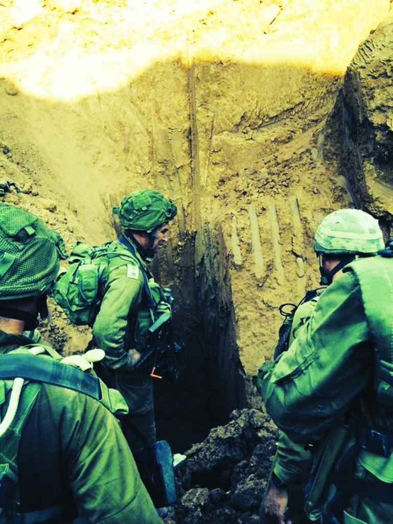 Israeli soldiers seen at the entrance to a tunnel found near Erez crossing, Gaza Strip, from where Hamas terrorists emerged Monday morning.  (IDF SPokesperson/FLASH90)