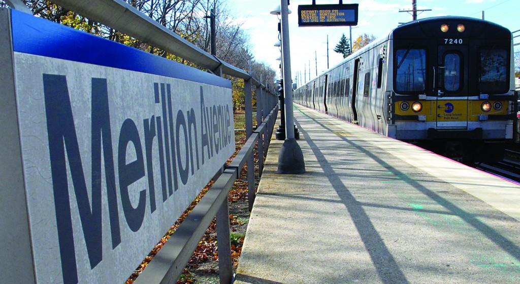 A Long Island Rail Road train pulls into the Merillon Avenue station in Mineola, N.Y. (AP Photo/Frank Eltman)
