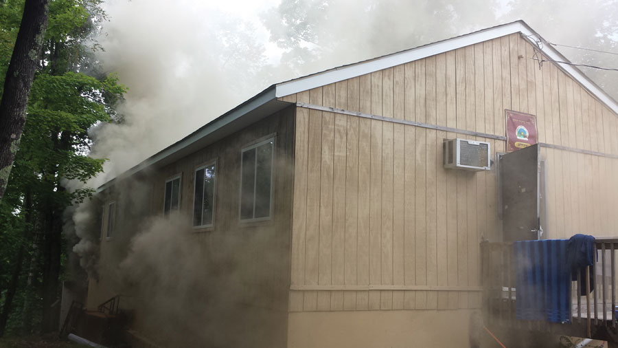 Smoke inundates the bunkhouse at camp.