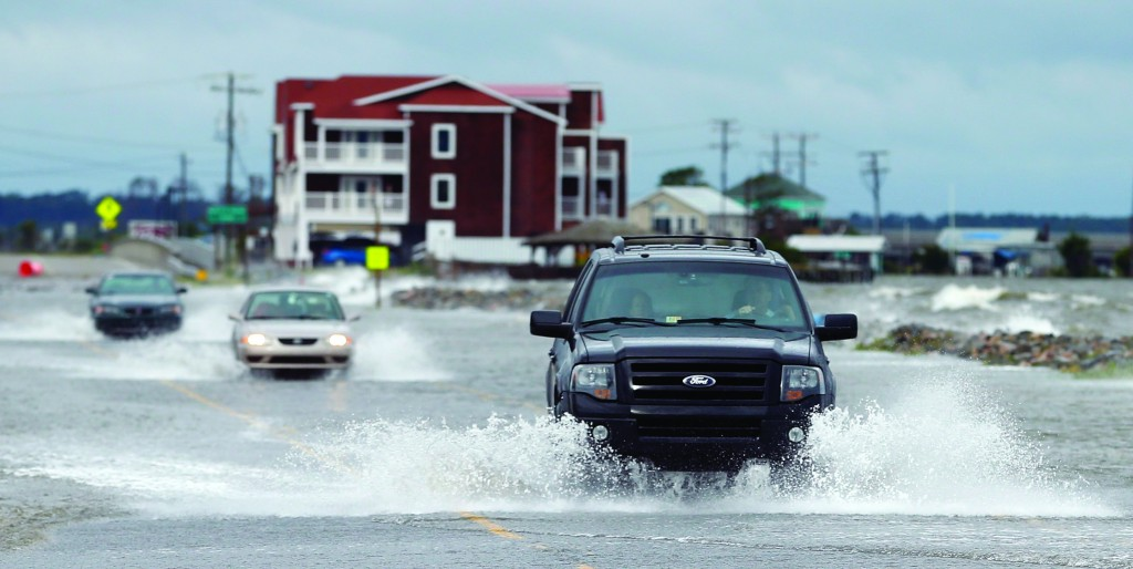 Vehicles make their way through high water as they drive after hurricane Arthur passed through in Nags Head, North Carolina  (REUTERS/Chris Keane)