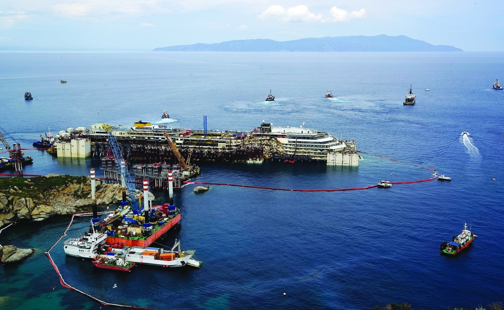 Operations to refloat and tow away the luxury cruise ship Costa Concordia get underway on the tiny Tuscan island of Giglio, Italy, Monday (AP Photo/Alessandro La Rocca, LaPresse)