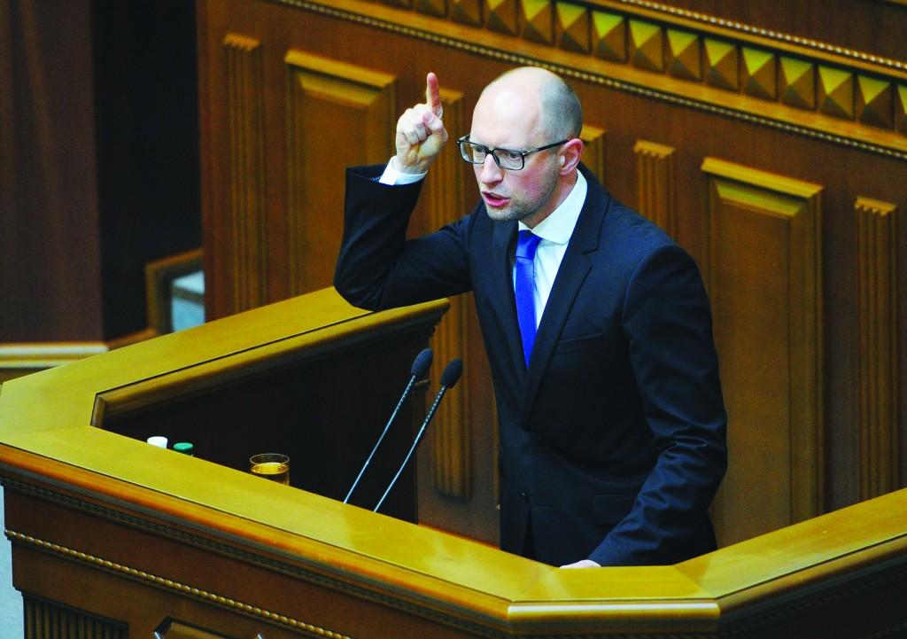 Ukrainian Prime Minister ArseniyYatsenyukspeaks in the parliament in Kiev, Thursday.  (AP Photo/Andrew Kravchenko, Pool)