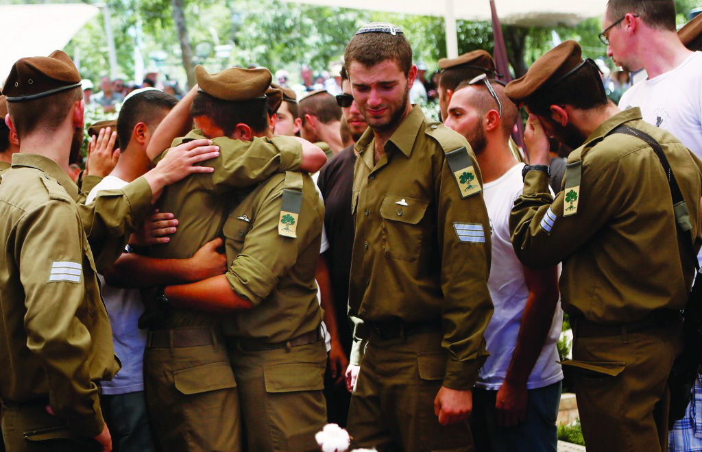 """At the levayah of Max Steinberg, Hy""""d, an IDF volunteer soldier from California who was killed in Gaza. (Miriam Alster/FLASH90)"""
