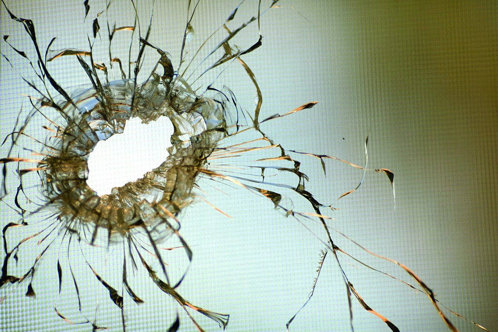 A shrapnel hole in a window caused by a rocket fired by terrorists in south Lebanon on Saturday hit a village near Nahariya in Northern Israel, Sunday (AP Photo/Ariel Schalit)