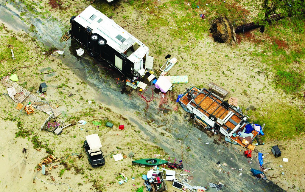 In this aerial photo debris lies scattered on the ground at Cherrystone Family Camping & RV Resort in Northampton County, Va., Thursday, after a severe storm swept through the area.  (AP Photo/The Virginian-Pilot, L. Todd Spencer)