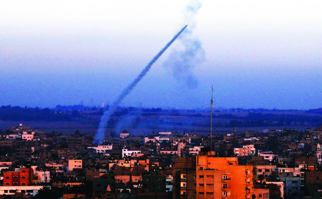 An M-75 rocket is launched from the coastal Gaza strip towards Israel by militants of the Ezz Al-Din Al Qassam militia, the military wing of Hamas movement. (EPA/ATEF SAFADIEPA/MOHAMMED SABER)