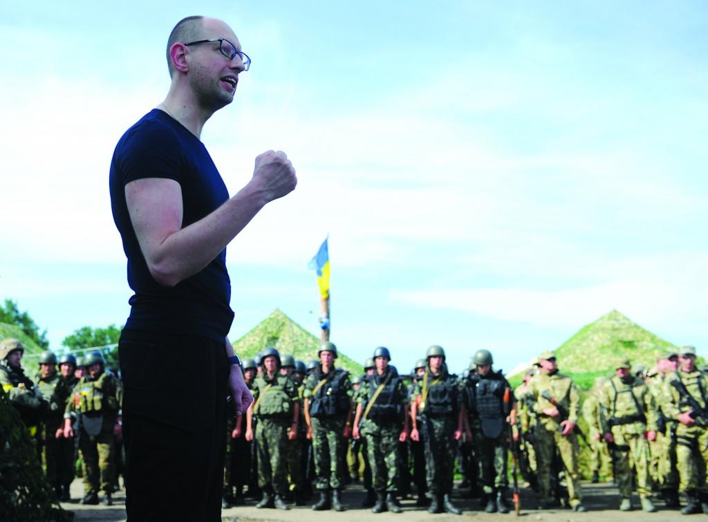 Ukrainian Prime Minister Arseniy Yatsenyuk, speaks to Ukrainian Army soldiers outside the eastern town of Slovyansk, Ukraine, Wednesday.  (AP Photo/Andrew Kravchenko, Pool)