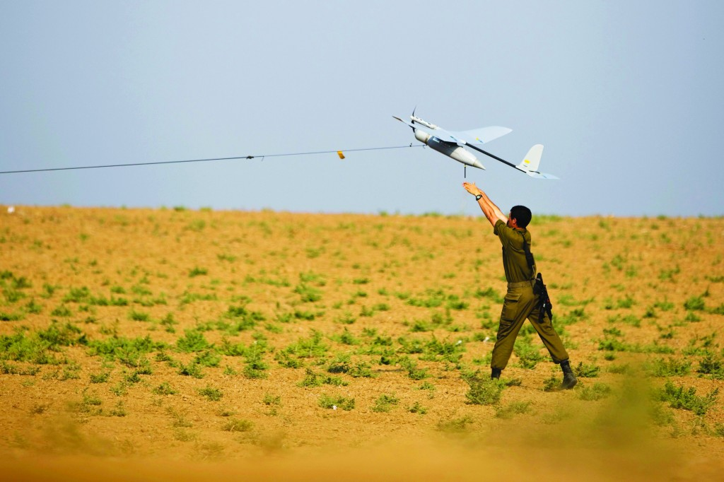 An Israeli soldier launches a drone outside the Gaza Strip, July 22. (REUTERS/Amir Cohen)