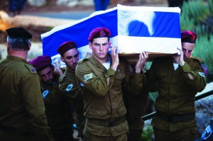 At the levayah of Israeli soldier Li Mat at Mount Herzl cemetery in Yerushalayim, Israel, Thursday. (EPA/ABIR SULTAN)