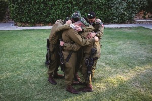 """At the military funeral of their friend and comrade, Dor Deri, Hy""""d, at Mount Herzl cemetery in Yerushalayim, Tuesday. (Flash 90)"""