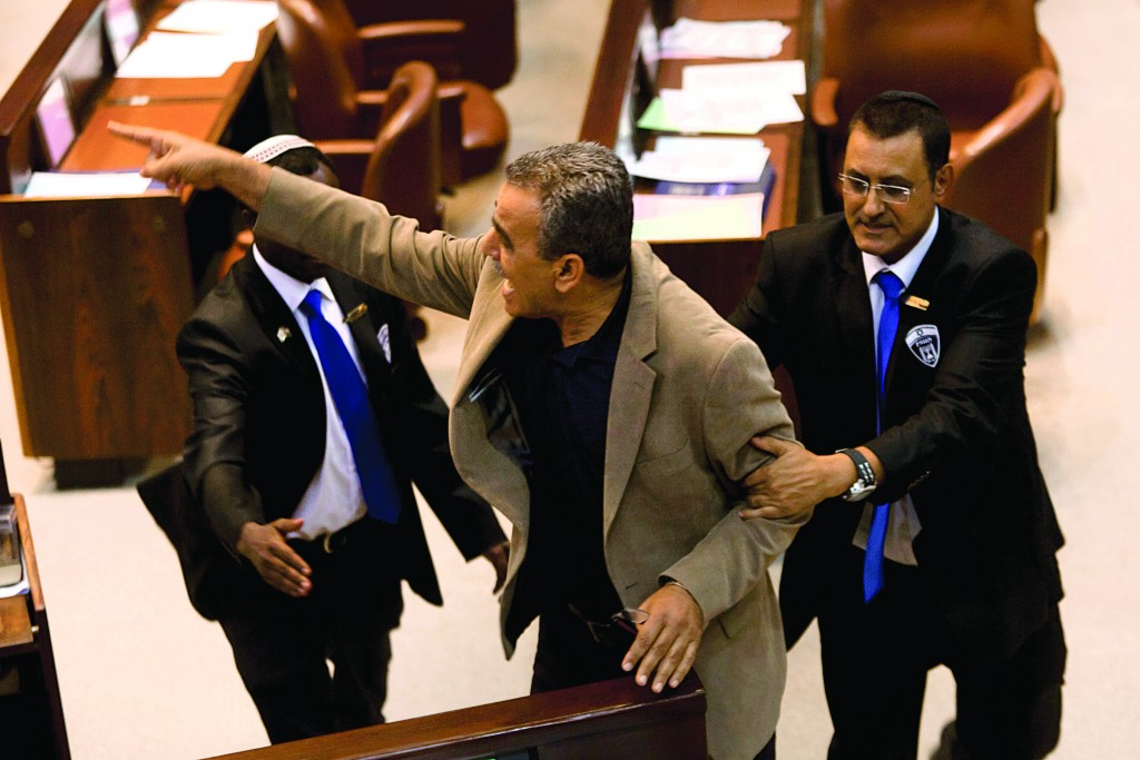 Dr. Jamal Zahalka of the Balad party being ejected from the plenum by Knesset security staff in a recent incident. Zahalka was one of the Arab MK's who skipped the presidential inaugural. (Flash90)