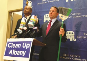 GOP gubernatorial candidate Rob Astorino and his running mate, Chris Moss, on Monday add visual aids to their promise to clean up Albany, in Buffalo, N.Y. (AP Photo/The Buffalo News, Mark Mulville)