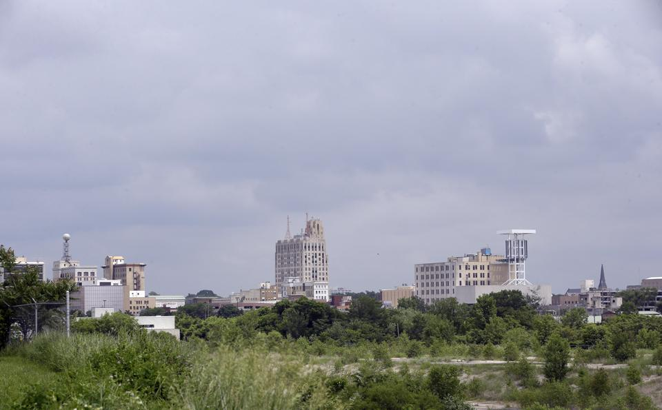 In a June 12, 2014 photo in Flint, Mich., the skyline of the city is seen from the west side.  (AP Photo/Carlos Osorio)