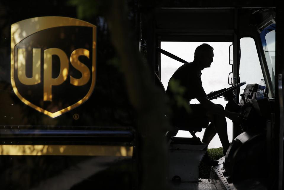 In this June 20, 2014 photo, United Parcel Service driver Marty Thompson starts up his truck after making a delivery in Cumming, Ga. (AP Photo/David Goldman)