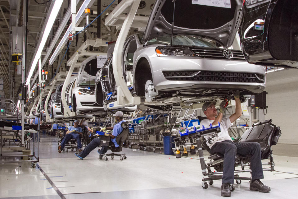 In this July 12, 2013 photo, employees at the Volkswagen plant in Chattanooga, Tenn., work on the assembly of a Passat sedan. (AP Photo/Erik Schelzig, File)