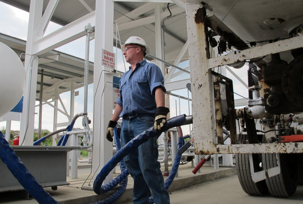 Larry Rice unloads propane from a tanker truck for storage at a facility in Bath, N.Y., operated by Crestwood Midstream Partners, on June 2, 2014. (Kevin G. Hall/MCT)