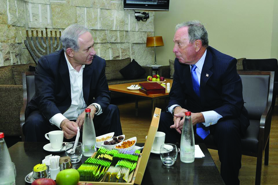Former New York Mayor Michael Bloomberg (R) on Wednesday meets with Prime Minister Binyamin Netanyahu during a 12-hour visit to Israel. (Twitter/MikeBloomberg)