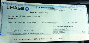 The check for $2,250 raised by OJPAC for funeral expenses.
