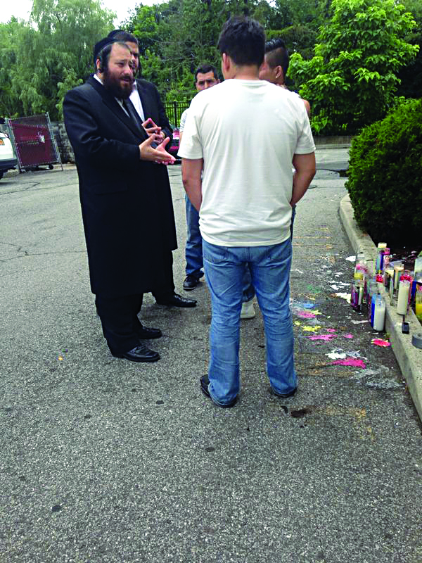 Rockland Majority Leader Aron Wieder with members of the Mero family at a memorial for Dominic Mero, a 20-month-old boy killed by a truck.