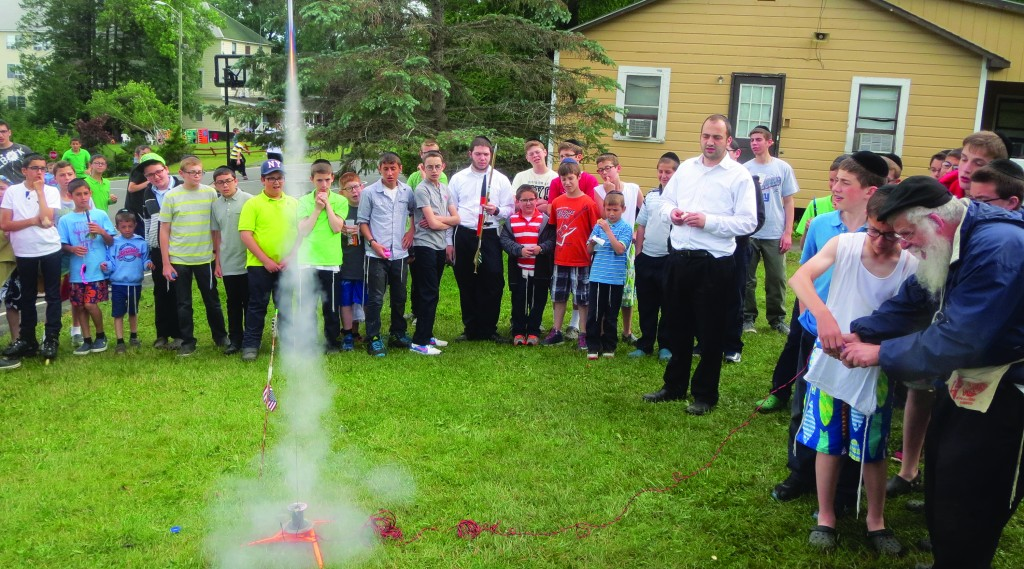 Rabbi Hillel Yarmove on Sunday puts up a rocket show for campers at Camp Agudah in Ferndale, N.Y.