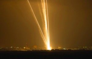 Light streaks and smoke trails are seen as rockets are launched from Gaza towards Israel on Wednesday. (REUTERS/Amir Cohen)
