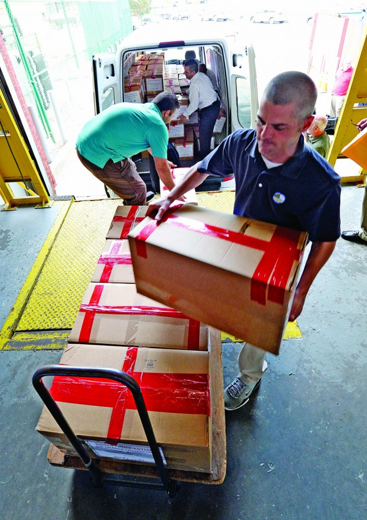 Scott Trzaskos on Monday receives boxes containing bids for casino sites in Schenectady, N.Y. (AP Photo )