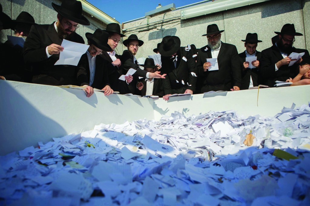 "Davening on Tuesday at the kever of the Lubavitcher Rebbe, Harav Menachem Mendel Schneerson, zt""l, on his 20th yahrtzeit, at Old Montefiore Cemetery in Queens. (Adam Ben Cohen/Chabad.org)"