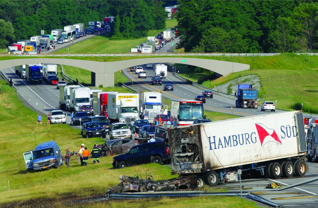 The scene Monday of a multi-vehicle accident involving trucks and cars on the New York Thruway in Mendon, N.Y. (AP Photo/Democrat & Chronicle, Shawn Dowd)