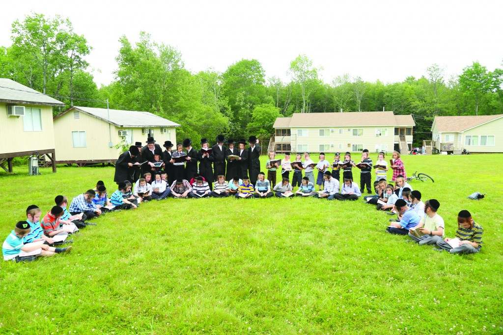 Children in Camp Divrei Chaim Sanz, in Kauneonga Lake, New York, saying Tehillim for our brothers in Israel.