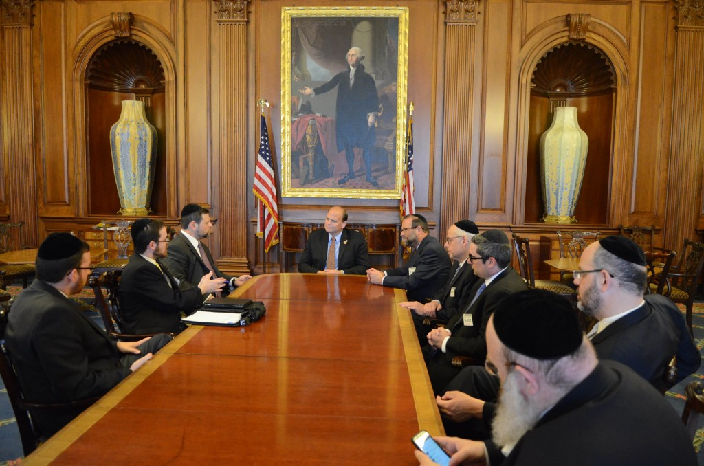 Members of Agudath Israel's Emergency Leadership Mission to Washington Leon Goldenberg (L), Chaskel Bennett (2nd L) and Ezra Friedlander (R) meeting with Congressman Doug Lamborn of Colorado (2nd R) to discuss increased funding for the Iron Dome defense system.