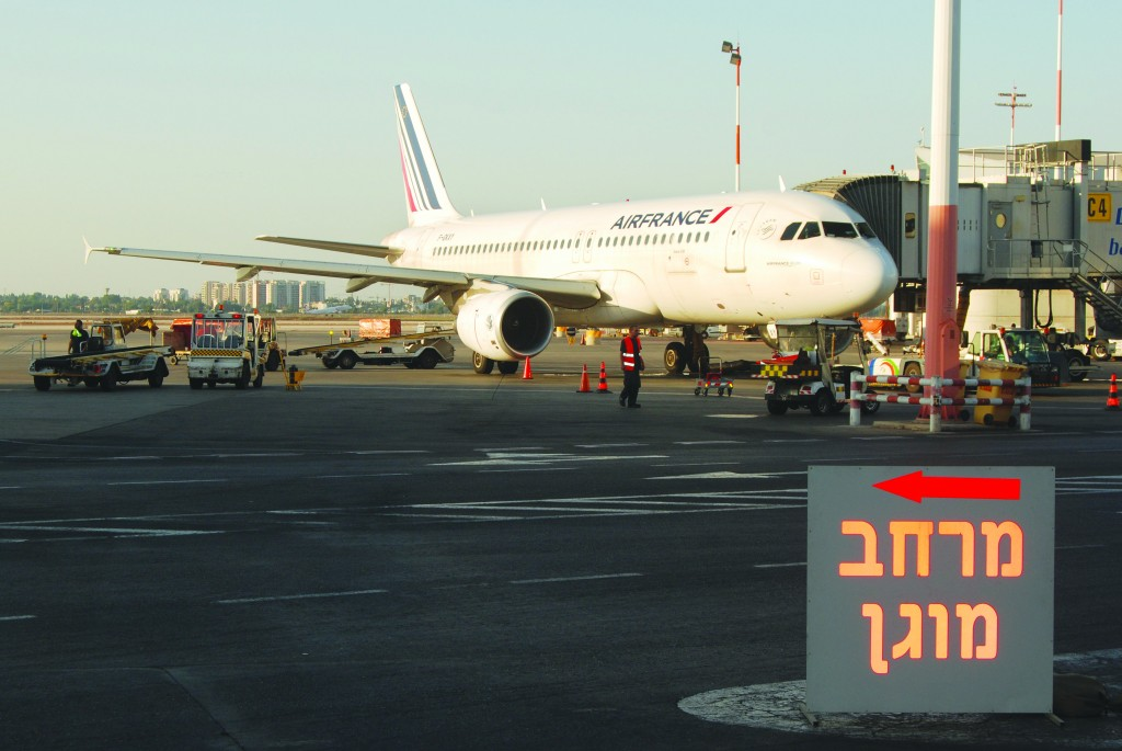 A sign pointing to a bomb shelter on the runway at the Ben Gurion International Airport near Tel Aviv. Air France was one of the European carriers that suspended flights this week. (Tsahi Ben Ami/Flash90)