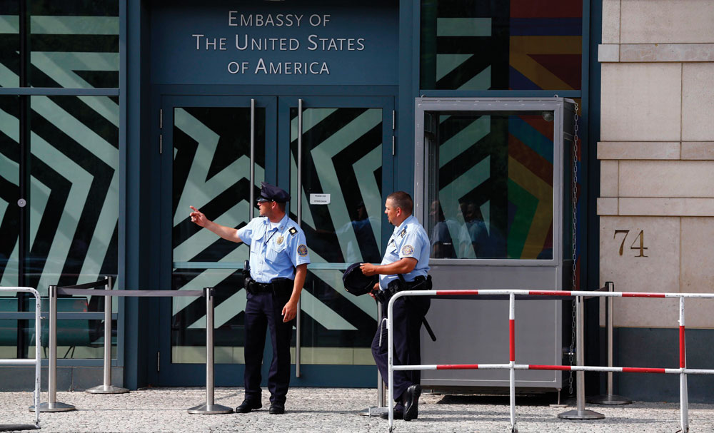 Security officers stand outside the U.S. Embassy in Berlin Thursday. (REUTERS/Thomas Peter)