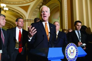 Senate Minority Whip John Cornyn (R-Texas), during a news conference at the Capitol in Washington, Tuesday. He is joined at rear by, from left, Sen. Roy Blunt (R-Mo.), Sen. John Barrasso (R-Wyo.) and Senate Minority Leader Mitch McConnell (R-Ky).  (AP Photo/J. Scott Applewhite)